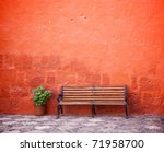 Long Chair Against Red Wall