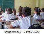 school children are... | Shutterstock . vector #719599621