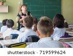 school children are... | Shutterstock . vector #719599624