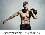 young muscular man training... | Shutterstock . vector #719600149
