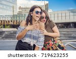 girls in the city gossiping and ... | Shutterstock . vector #719623255