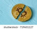 coin bitcoin is broken in half. ... | Shutterstock . vector #719631127