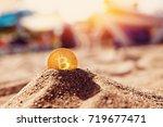 bitcoin on golden sand  in...   Shutterstock . vector #719677471