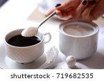 woman hand adding a lot of... | Shutterstock . vector #719682535