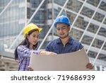 engineerwoman and worker with... | Shutterstock . vector #719686939