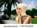 a happy emotional muslim girl... | Shutterstock . vector #719702305