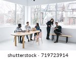 young professionals working on... | Shutterstock . vector #719723914