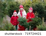 family selecting christmas tree.... | Shutterstock . vector #719724421