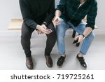 young men using smart phones | Shutterstock . vector #719725261
