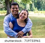 latino husband and wife smiling ...   Shutterstock . vector #719733961