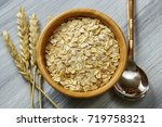 overhead view of a bowl of oats ... | Shutterstock . vector #719758321