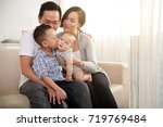 happy young vietnamese family... | Shutterstock . vector #719769484