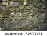 stone wall of the old barn | Shutterstock . vector #719778991