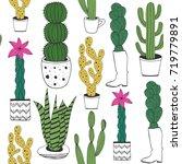 hand drawn cacti in pots.... | Shutterstock .eps vector #719779891