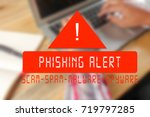 Small photo of Blurred Vintage wooden desktop top view, male hands using a laptop with PHISHING ALERT. Internet Security concept