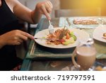 beautiful woman  steak dinner... | Shutterstock . vector #719797591