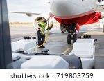 mid adult crew member charging... | Shutterstock . vector #719803759