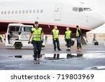 confident worker in walking... | Shutterstock . vector #719803969