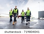 low angle view of workers...   Shutterstock . vector #719804041