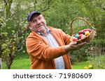 Elderly Man Holding Basket Of...