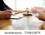 Small photo of business people and lawyers discussing contract papers sitting at the table. Concepts of law, advice, legal services.