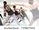 group asian women stretching... | Shutterstock . vector #719827441