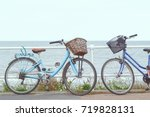 two bicycles with baskets... | Shutterstock . vector #719828131
