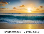 large wave crashes on shore ... | Shutterstock . vector #719835319