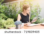 young caucasian businesswoman... | Shutterstock . vector #719839405