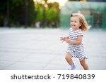 cute little girl runs around...   Shutterstock . vector #719840839