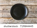 empty black plate on an old... | Shutterstock . vector #719844445