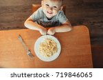 the child in the kitchen at the ...   Shutterstock . vector #719846065