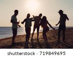 people dancing in summer | Shutterstock . vector #719849695