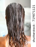 hair with a nourishing mask   Shutterstock . vector #719871121
