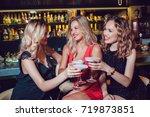 beautiful women are sitting on... | Shutterstock . vector #719873851