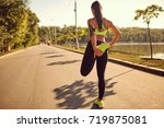 a runner girl is doing... | Shutterstock . vector #719875081