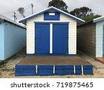 striking blue and white bathing ... | Shutterstock . vector #719875465