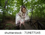 strange character in the forest | Shutterstock . vector #719877145