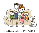 big family sitting on a couch | Shutterstock .eps vector #719879311