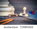 Small photo of Original and Copy concept. Rubber Stamp on desk in the Office. Business and work background