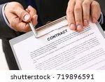 handsome man in suit offer... | Shutterstock . vector #719896591