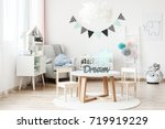 banner and lamp above small... | Shutterstock . vector #719919229