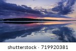 evening sunset over the lake | Shutterstock . vector #719920381