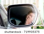 Small photo of Shadow reflection of the car glass . man use their hand gag with drowsiness while driving.