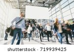crowd of anonymous blurred... | Shutterstock . vector #719939425