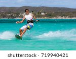 kitesurfer enjoying his sport... | Shutterstock . vector #719940421