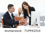 employees discussing business... | Shutterstock . vector #719942314