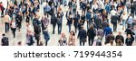 blurred large crowd of people | Shutterstock . vector #719944354