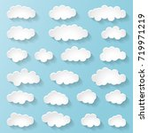 set of white clouds on a blue... | Shutterstock .eps vector #719971219