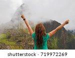 young woman traveler raising... | Shutterstock . vector #719972269